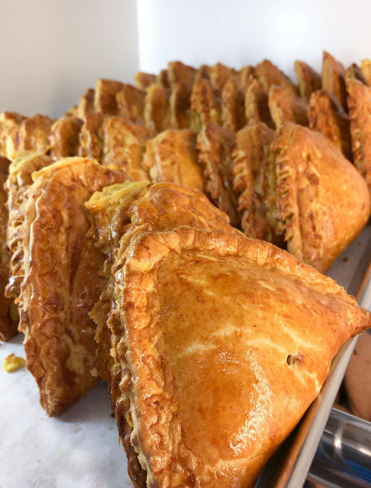 Empanadas Empanadas are soft turnovers that come with a variety of fillings such as apple, pineapple, pumpkin and cheese.
