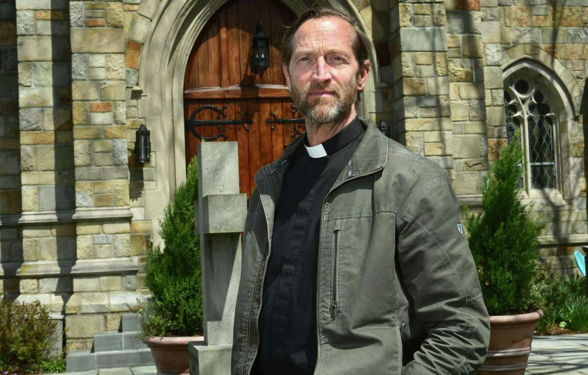 Rev. Daniel Simons at St. Paul's on the Green Episcopal Church Wednesday, April 15, 2020, in Norwalk, Conn. Simons joined the parish on February 1 and closed the church by March 12. He estimates at least one to two dozen parishioners have been sick with the coronavirus and is trying to guide his new church while operating remotely. St. Paul's has lost three parishioners to coronavirus: Joe Hawley, Conservation Commission Chairman Joe Verel, and former City Clerk Mary Roman.