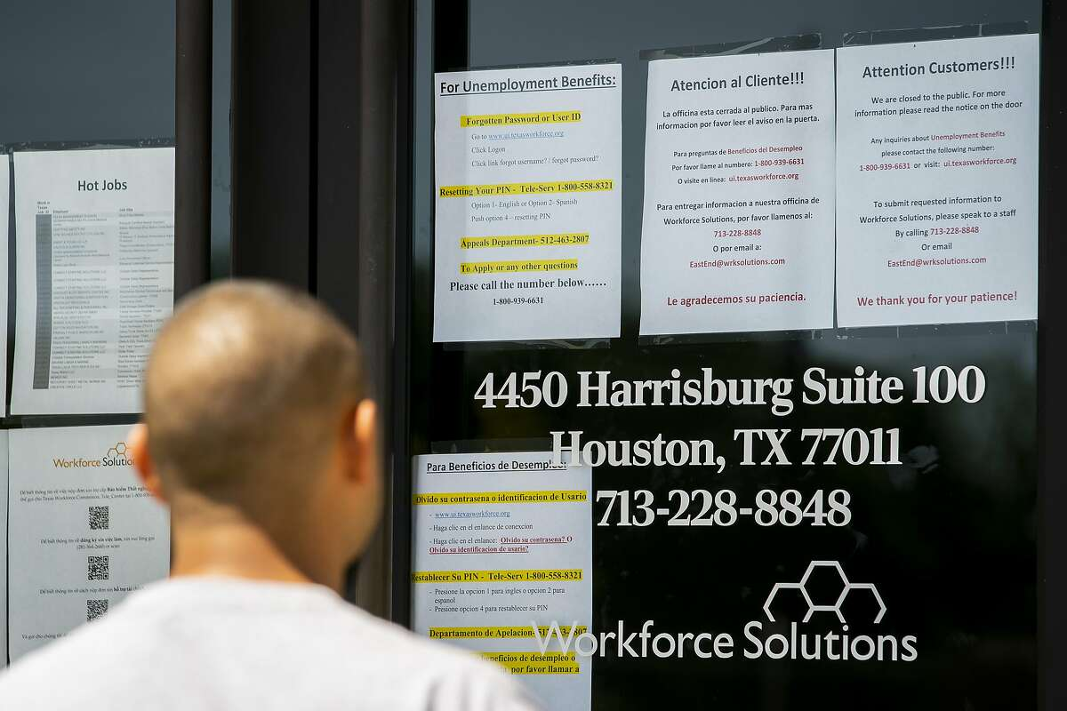 A man who did not want to be identified finds that the Workforce Solutions office is closed due to the Covid-19 outbreak, Wednesday, April 1, 2020, on Harrisburg in east Houston. Services are still available online and by phone, but the physical office is closed. The man was laid off from the construction company he worked for on Tuesday. It was a small company that worked primarily in hospitals, he said, and work was significantly slowing down as hospitals moved away from having non-essential people in the facilities.