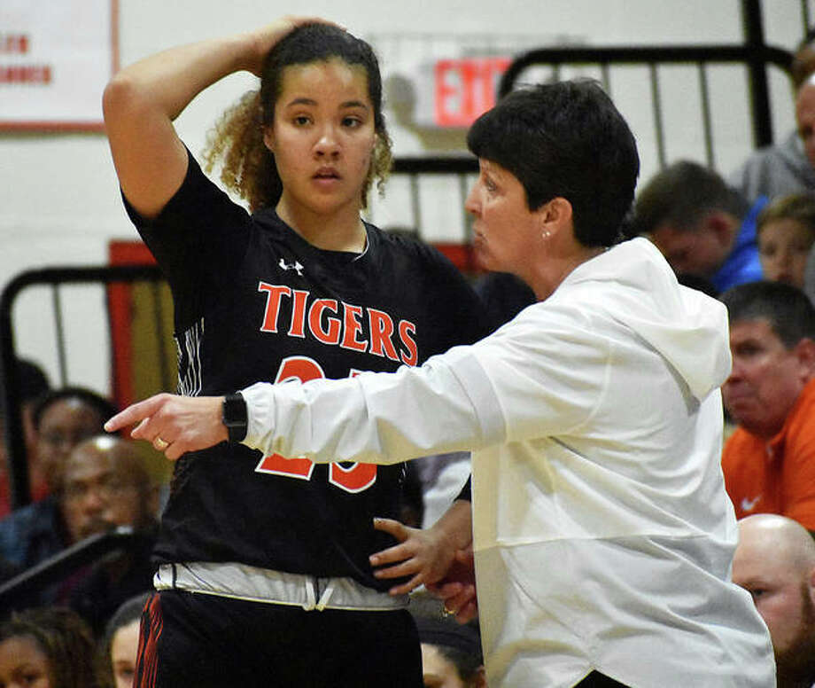 Edwardsville girls basketball coach Lori Blade talks to Sydney Harris during a game at the Visitation Christmas Tournament in December in St. Louis.