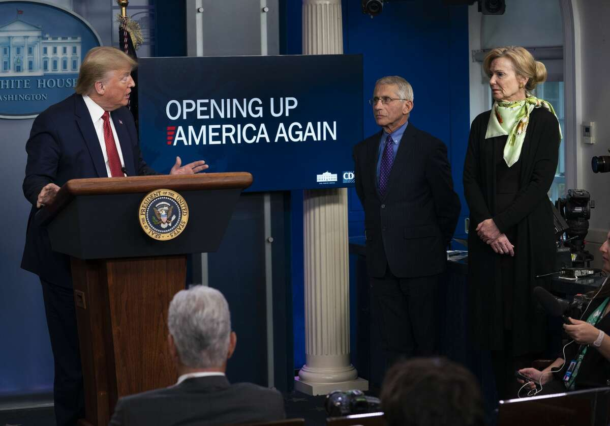 President Donald Trump speaks at a news conference about the coronavirus, as Dr. Anthony Fauci, director of the National Institute of Allergy and Infectious Diseases, and Dr. Deborah Birx, White House coronavirus response coordinator, listen, at the White House in Washington, Thursday, April 16, 2020. (Doug Mills/The New York Times)