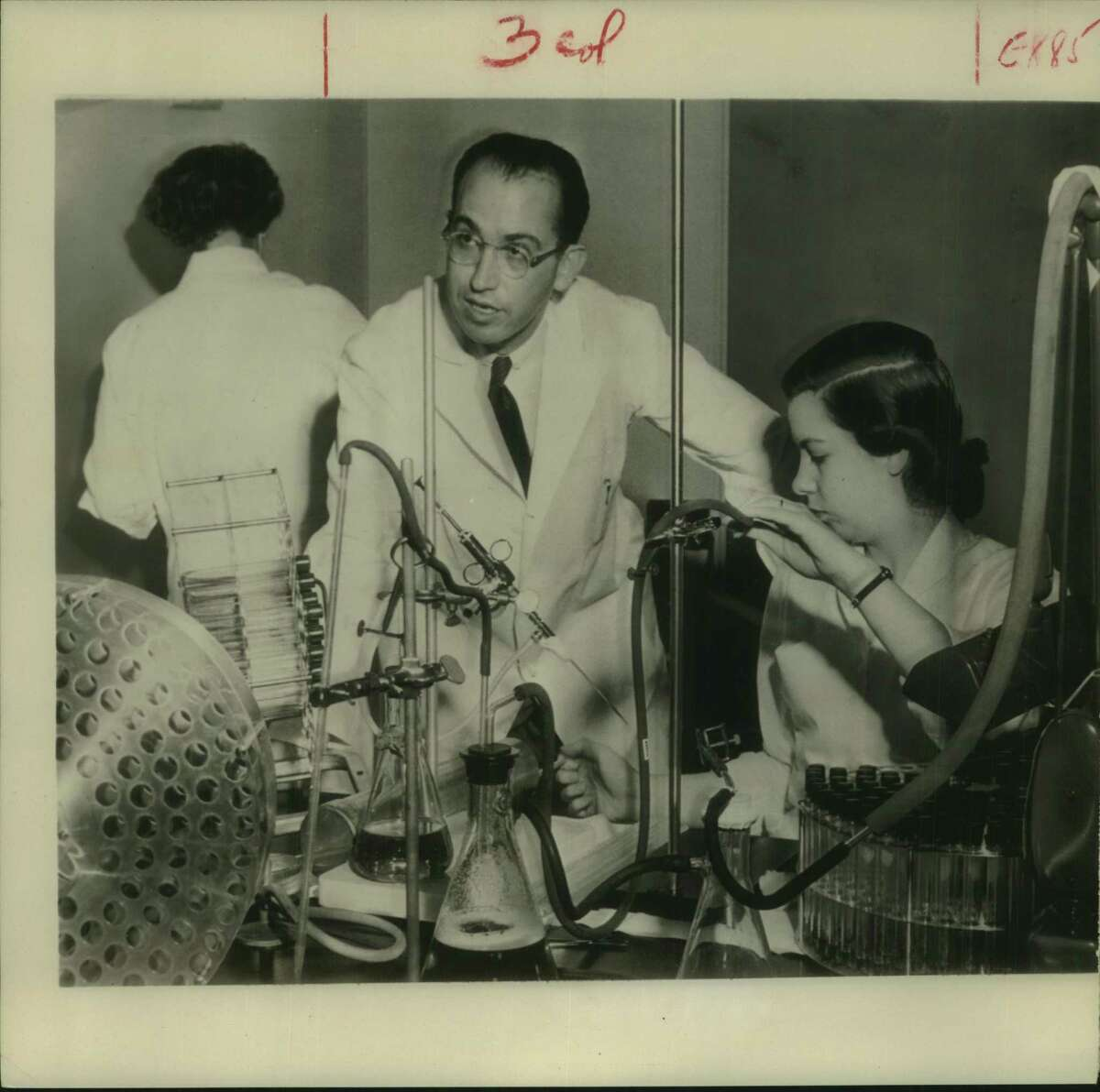 Jonas Salk and nurses work on polio vaccine in his lab. Salk later developed a vaccine for polio that was eventually distributed in Montgomery County.