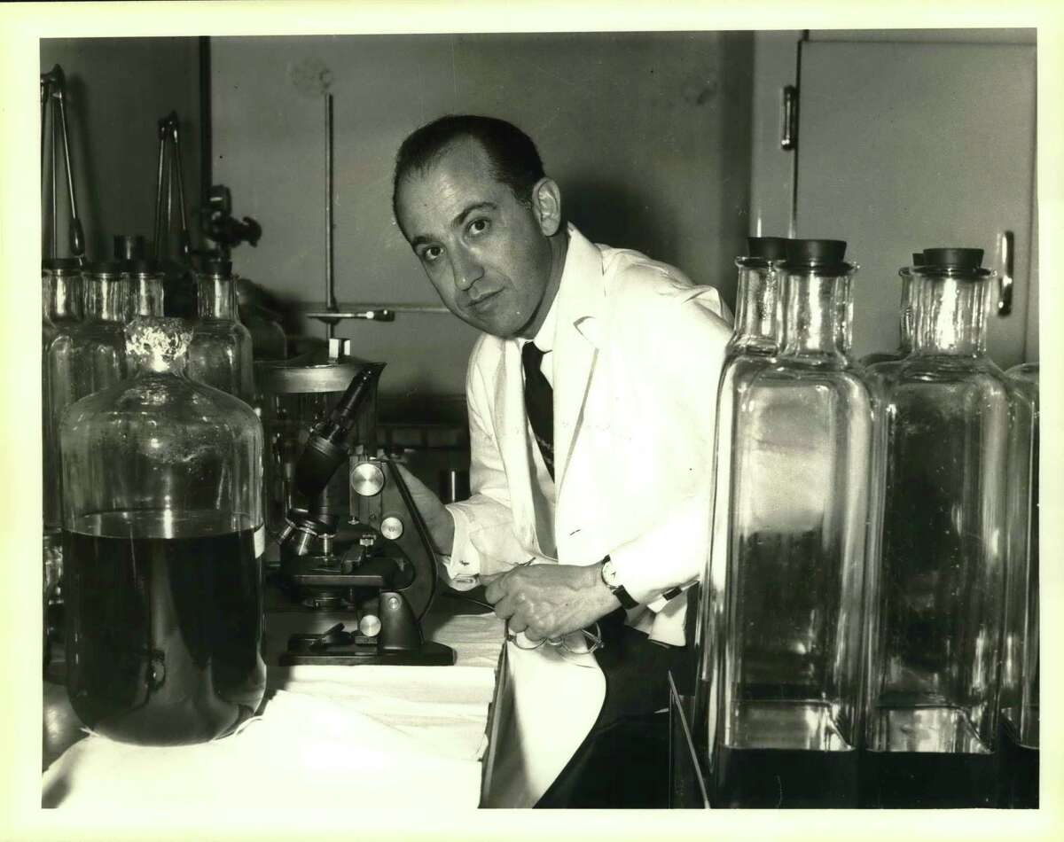 On April 12, 1955, the world rejoiced when this young scientist, Dr. Jonas E. Salk, seen here at work in his laboratory in Pittsburgh, discovered the cure for polio. This file photo is from April 18, 1955.