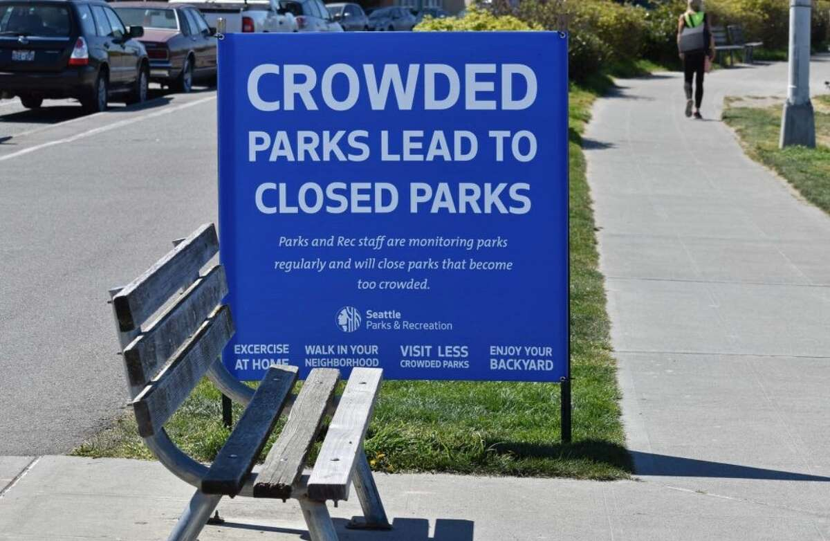 A Seattle Parks & Recreation sign posted along Alki Beach on April 16, 2020.