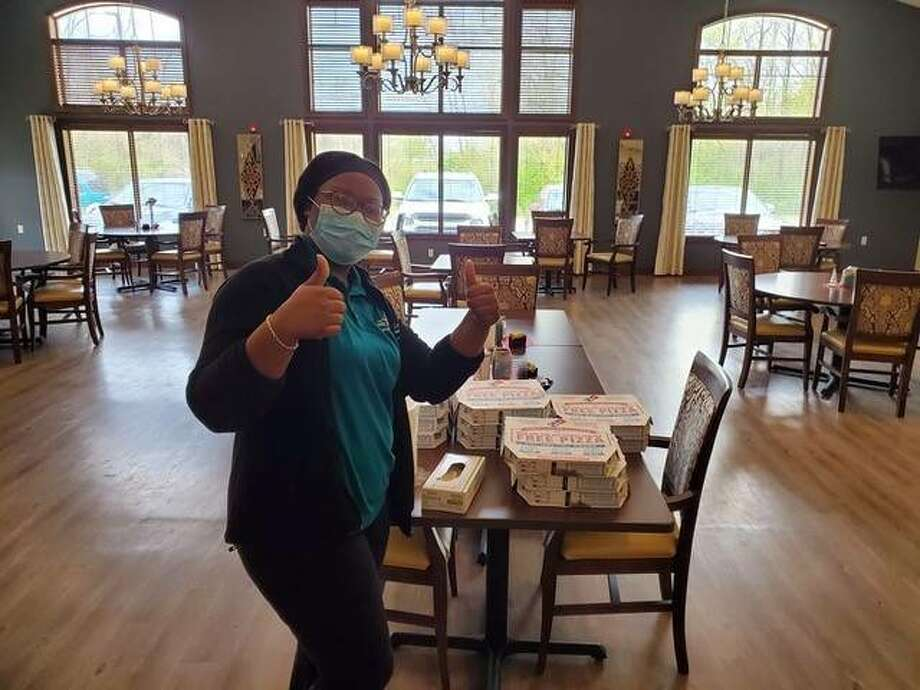 A healthcare worker at an area nursing home notes her thanks for pizzas recently provided by the Sivia Law Firm in Edwardsville and East Alton. The firm sent more than 200 pizzas to area nursing homes.