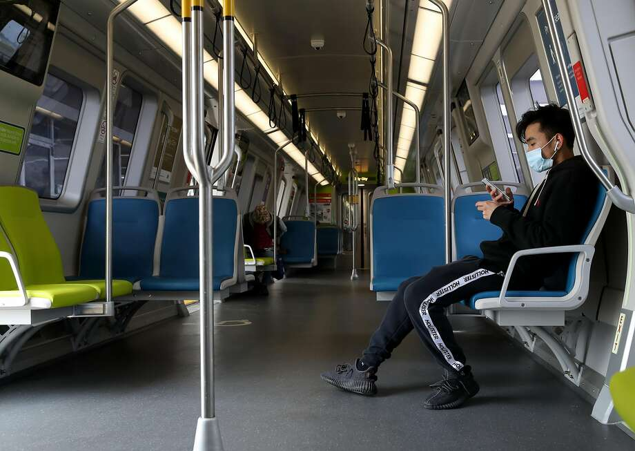 FILE: A BART passenger wears a protective mask while riding on a train on April 8, 2020 in San Francisco. Photo: Justin Sullivan / Getty Images