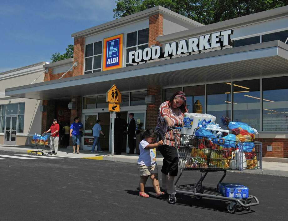 An Aldi supermarket customer brings groceries to her car in New Haven. Photo: Hearst Connecticut Media File Photo