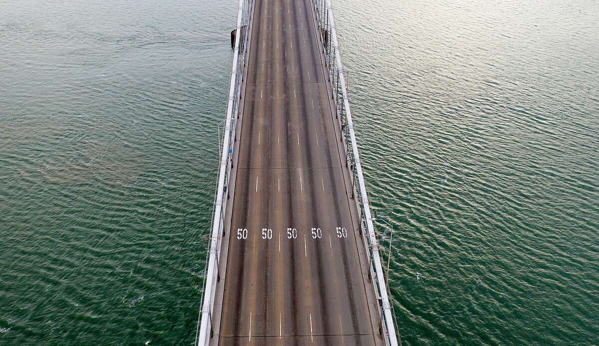 The upper deck of the Bay Bridge rests empty at 6:34 p.m. as seven Bay Area counties enter the first day of shelter-in place-orders to slow coronavirus spread on Tuesday, March 17, 2020, in San Francisco.
