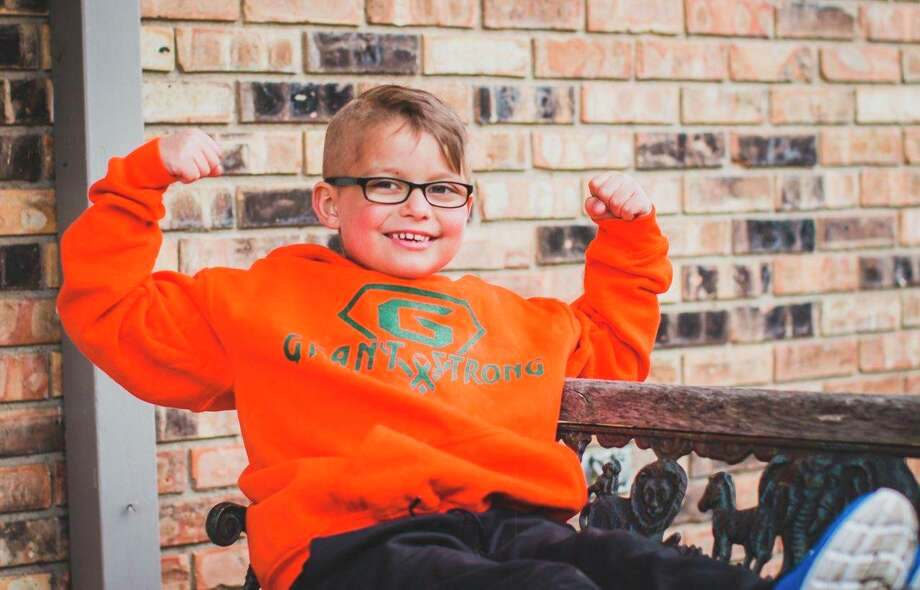 "Grant Maciag is pictured in a ""Grant Strong"" sweatshirt, which is part of the fundraising efforts for his family on the part of the Adams School community. (Photo provided)"
