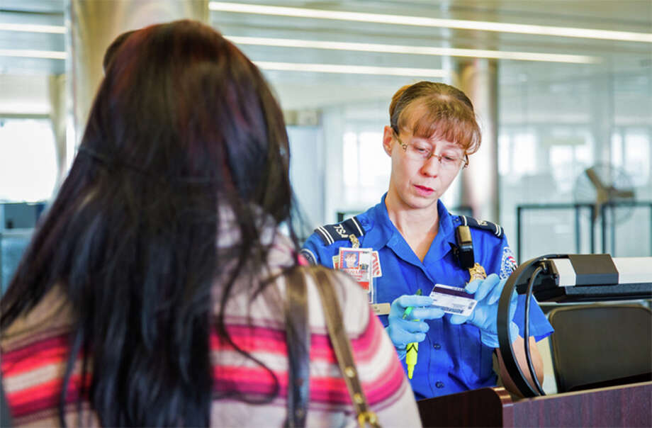 The TSA now allows travelers to wear face masks during airport screening. Photo: Dept. Of Homeland Security