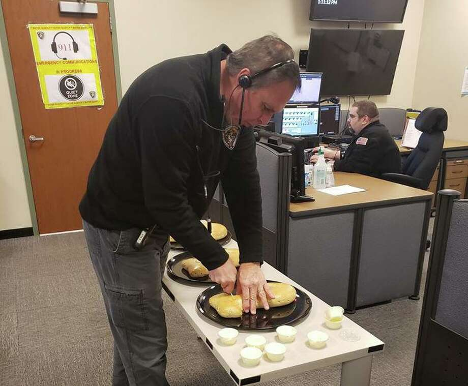 Emergency dispatchers at the Greenwich public-safety complex got bagels and cream cheese, courtesy of Upper Crust Bagel Company, as part of National Emergency Dispatcher Week. Photo: / Contributed