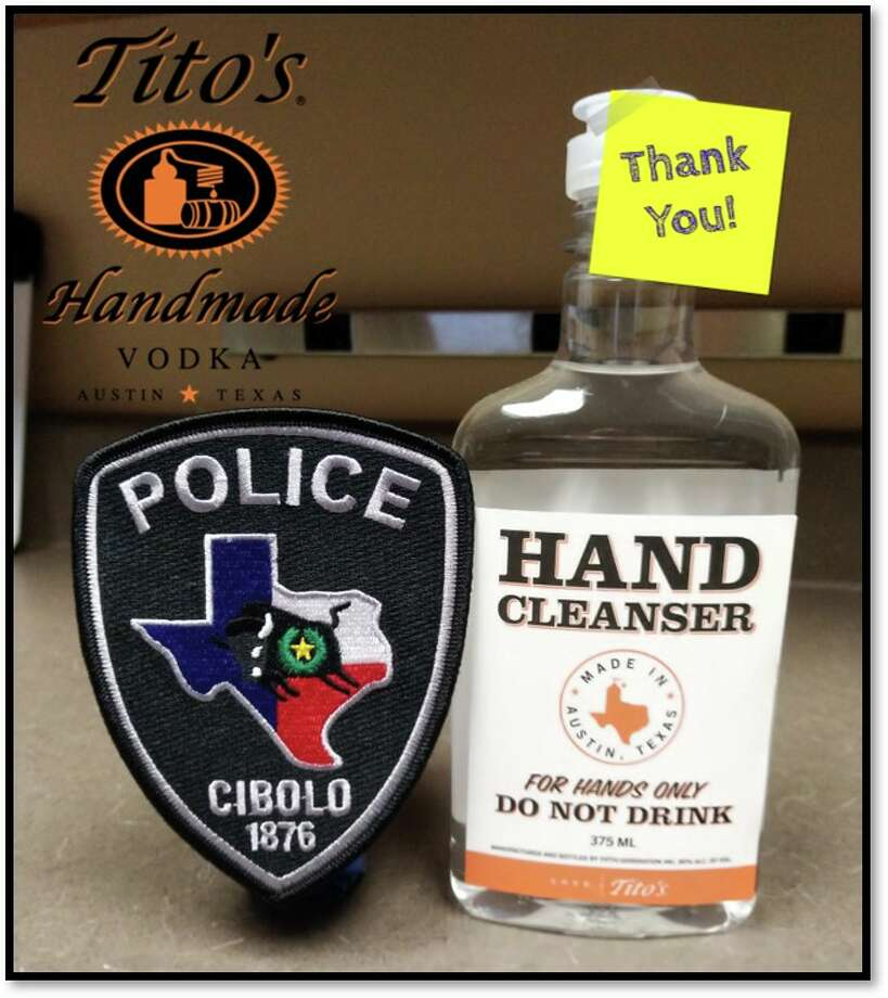 With the coronavirus causing a shortage of hand sanitizer, Tito's Handmade Vodka donated its company-made hand cleanser to the Cibolo Police Department on Thursday, according to a Facebook post from the department. Photo: Cibolo Police Department