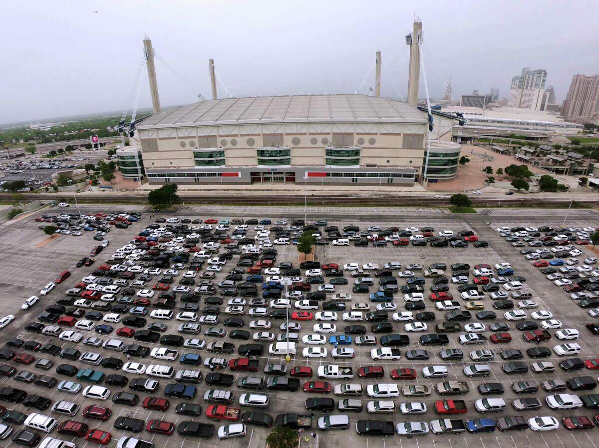 People in their vehicles line up at the Alamodome for a San Antonio Food Bank distribution on Friday, April 17, 2020. About 2,200 families were registered for the distribution.