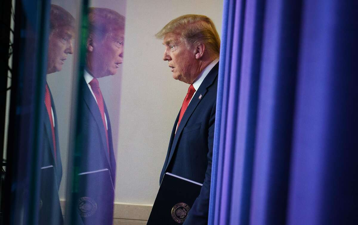 """(FILES) In this file photo taken on April 16, 2020 US President Donald Trump arrives for the daily briefing on the novel coronavirus, which causes COVID-19, in the Brady Briefing Room of the White House in Washington, DC. - President Donald Trump on April 17, 2020 said China's real death toll from coronavirus was """"far higher,"""" even after officials issued a new count doubling the number of dead in Wuhan, where the pandemic began. """"China has just announced a doubling in the number of their deaths from the Invisible Enemy. It is far higher than that and far higher than the U.S., not even close!"""" Trump tweeted. (Photo by MANDEL NGAN / AFP) (Photo by MANDEL NGAN/AFP via Getty Images)"""