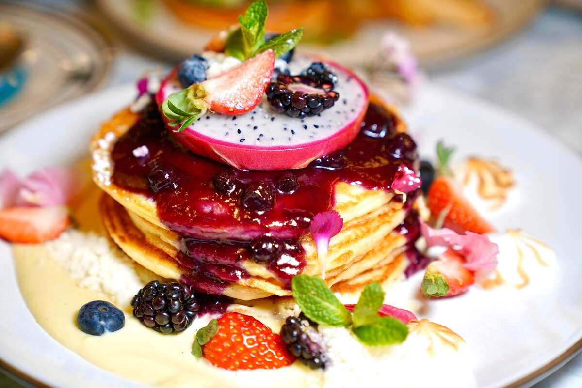 Ricotta Pancakes - fluffy pancakes with blueberry compote, warm maple syrup and fresh fruits - are available for breakfast delivery from new San Francisco restaurant Son and Garden.