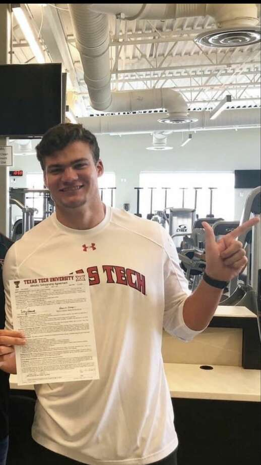 """Andrews grad Jacob Mechler does the """"guns up salute"""" after signing to transfer to the Texas Tech track & field program. He competed at Abilene Christian as a freshman this season. Courtesy photo."""