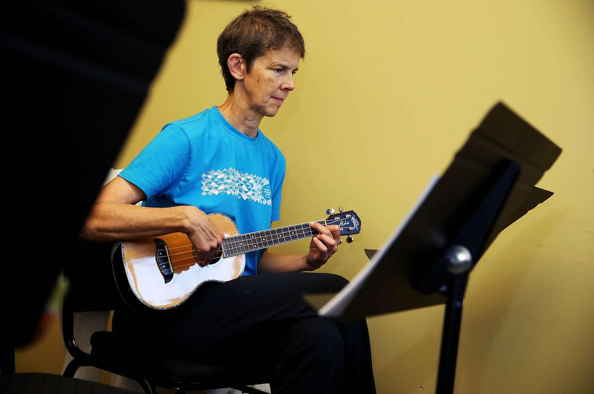 Student Vicky Thomas strums her instrument as Hiram Bell teaches a Beginning Ukulele class at Freight and Salvage in Berkeley, Calif., on Thursday, October 3, 2019. Freight and Salvage offers dozens of classes a year on traditional music. They are reclassifying all the instructors as employees because of California's new gig work law, AB5.
