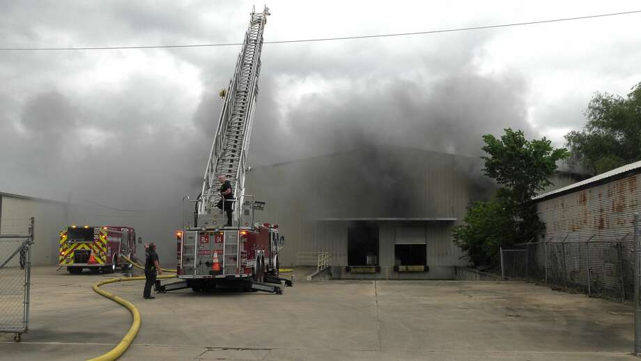 Houston firefighters tackle a fire inside a warehouse in the 6400 block of Eppes Street on Friday, April 17, 2020. Photo: Jay R. Jordan / Houston Chronicle