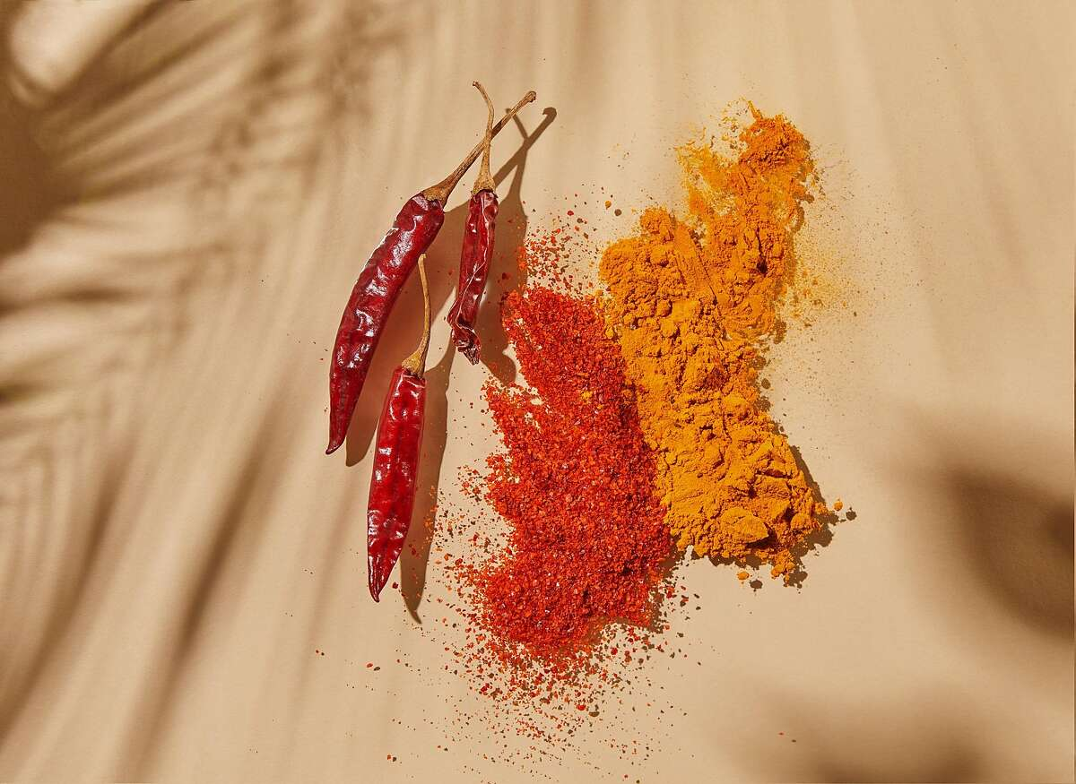Guntur Sannam Chilli is seen in its whole and powdered forms alongside Pragati Turmeric (right), the first spice Oakland's Diaspora Co. sourced from India.