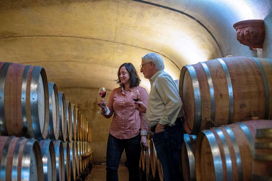 Adelsheim Vineyard winemaker Gina Hennen (left) and founder David Adelsheim taste wine at the winery in Newberg, Ore. Photo: Amanda Lucier / Special To The Chronicle 2019