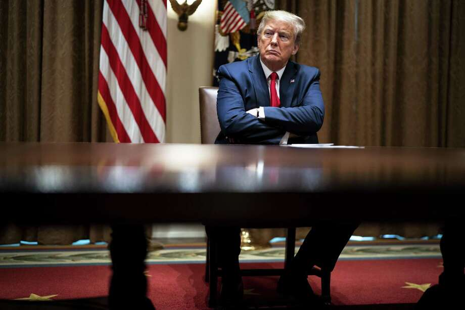 President Donald Trump listens to health care executives last week. One reader is impressed with Trump's self-proclaimed power. Photo: Doug Mills /Getty Images / 2020 Getty Images