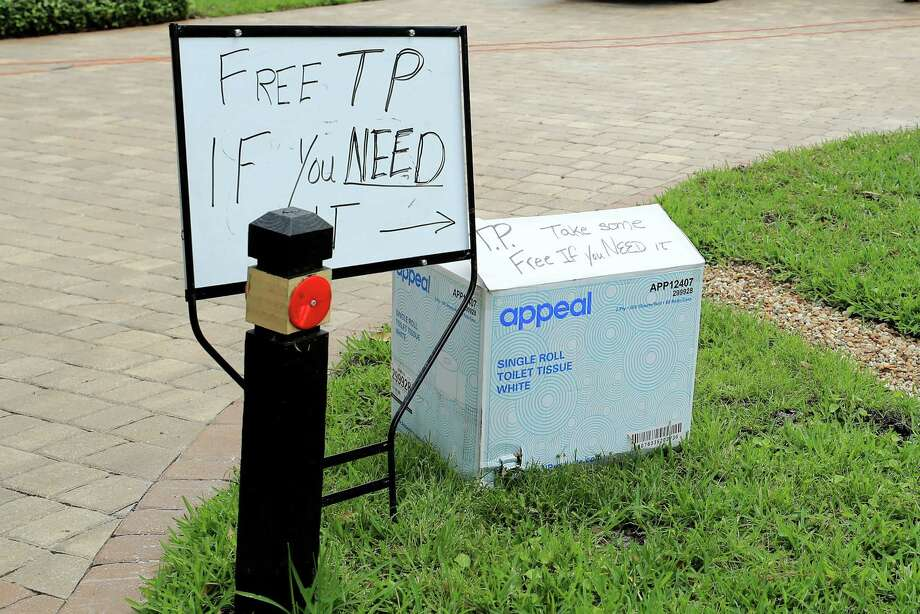 A sign for free toilet paper appeared in Jacksonville Beach, Fla., this month. Generosity takes many forms and often comes from surprising places. Photo: Sam Greenwood /Getty Images / 2020 Getty Images