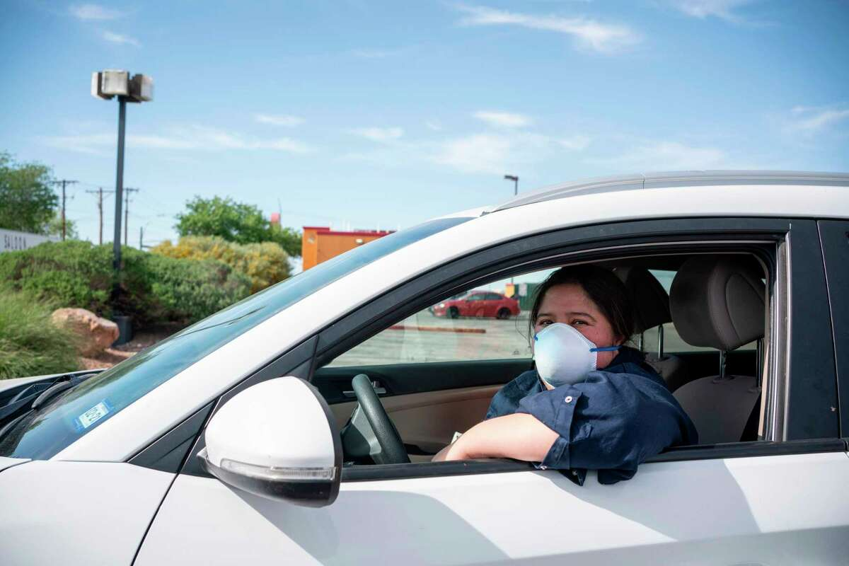 Jen Apodaca, organizer for the Detained Migrant Solidarity Comittee, poses for a portrait in her car after she participated in a caravan protest around Immigration and Customs Enforcement El Paso Processing Center to demand the release of ICE detainees due to safety concerns amidst the COVID-19 outbreak on April 16, 2020 in El Paso, Texas. - One detainee has already tested positive in the nearby Otero County Processing Center in New Mexico, and more cases are feared to appear in the detention centers where social distancing is often not an option. (Photo by Paul Ratje / Agence France-Presse / AFP) (Photo by PAUL RATJE/Agence France-Presse/AFP via Getty Images)
