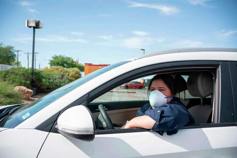 Jen Apodaca, organizer for the Detained Migrant Solidarity Comittee, poses for a portrait in her car after she participated in a caravan protest around Immigration and Customs Enforcement El Paso Processing Center to demand the release of ICE detainees due to safety concerns amidst the COVID-19 outbreak on April 16, 2020 in El Paso, Texas. - One detainee has already tested positive in the nearby Otero County Processing Center in New Mexico, and more cases are feared to appear in the detention centers where social distancing is often not an option. (Photo by Paul Ratje / Agence France-Presse / AFP) (Photo by PAUL RATJE/Agence France-Presse/AFP via Getty Images) Photo: PAUL RATJE, Contributor / Agence France-Presse/AFP Via Getty Images / AFP