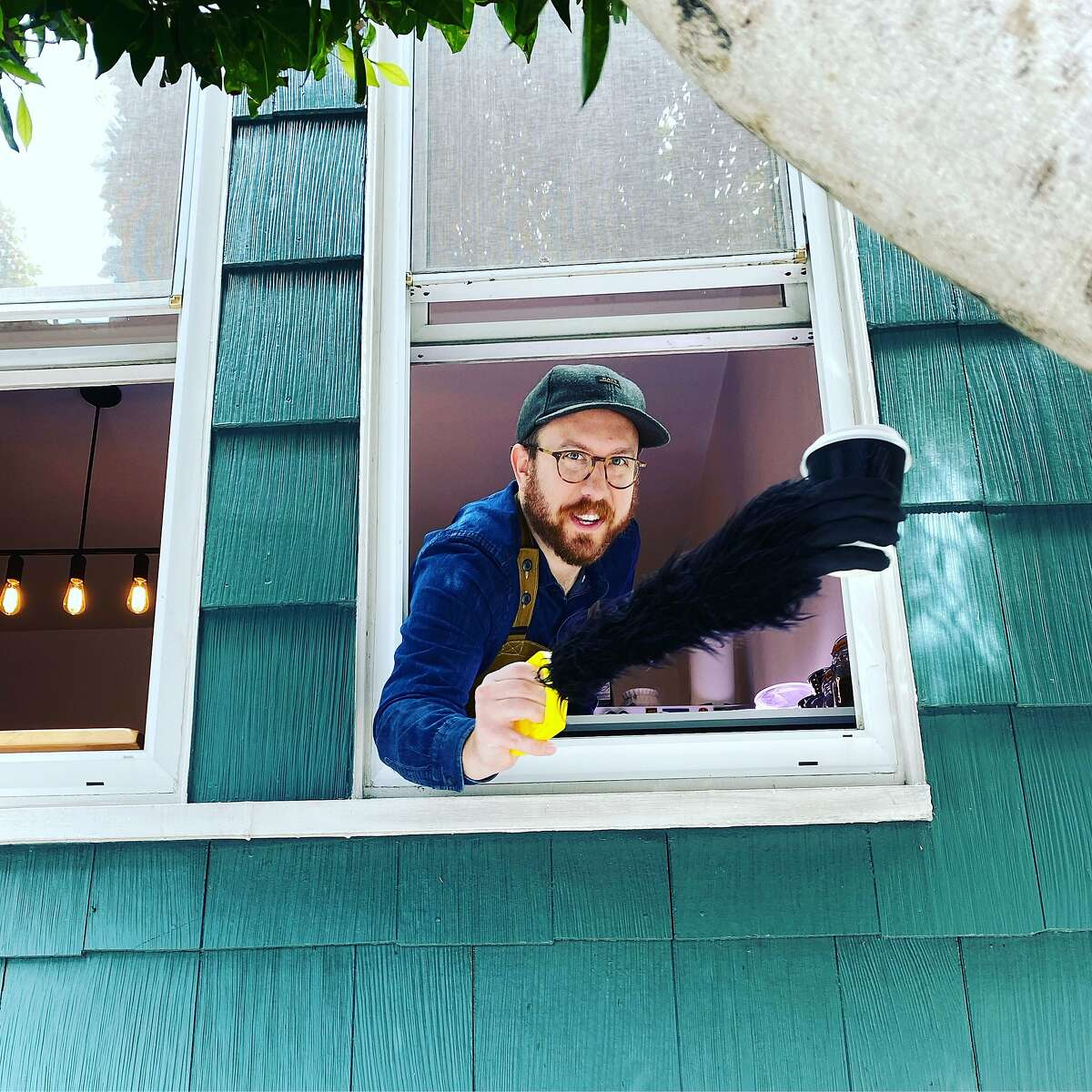North Beach resident Ben Ramirez has been making and handing out cups of coffee through a sidewalk-level window of his flat. credit:Ben Ramirez