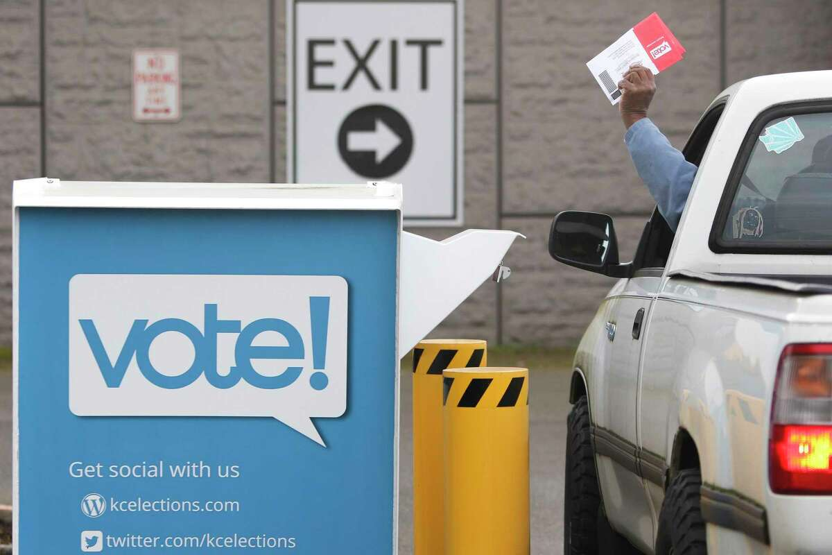 Voters drop off their presidential primary mail-in ballots at a drop box at King County Elections in Renton, Wash. on March 10, 2020. (Jason Redmond/AFP/Getty Images/TNS)