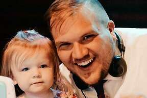 Brock Elmore and his 2-year-old daughter Addison pose for a photo during his appearance as a disc jockey at a Daddy-Daughter dance in Belleville on March 14. Through his business, Let's Celebrate DJ, Elmore has donated $580 from two Facebook Live performances to help pay for meals for Main Street Community Center clients during the COVID-19 pandemic.