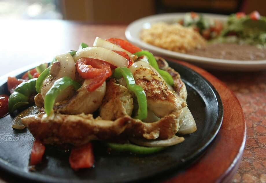 In response to the restaurant industry challenges presented by the coronavirus crisis, grocery giant H-E-B is carrying fresh prepared foods like these chicken fajitas from Los Barrios. Photo: Staff File Photo / hmontoya@express-news.net