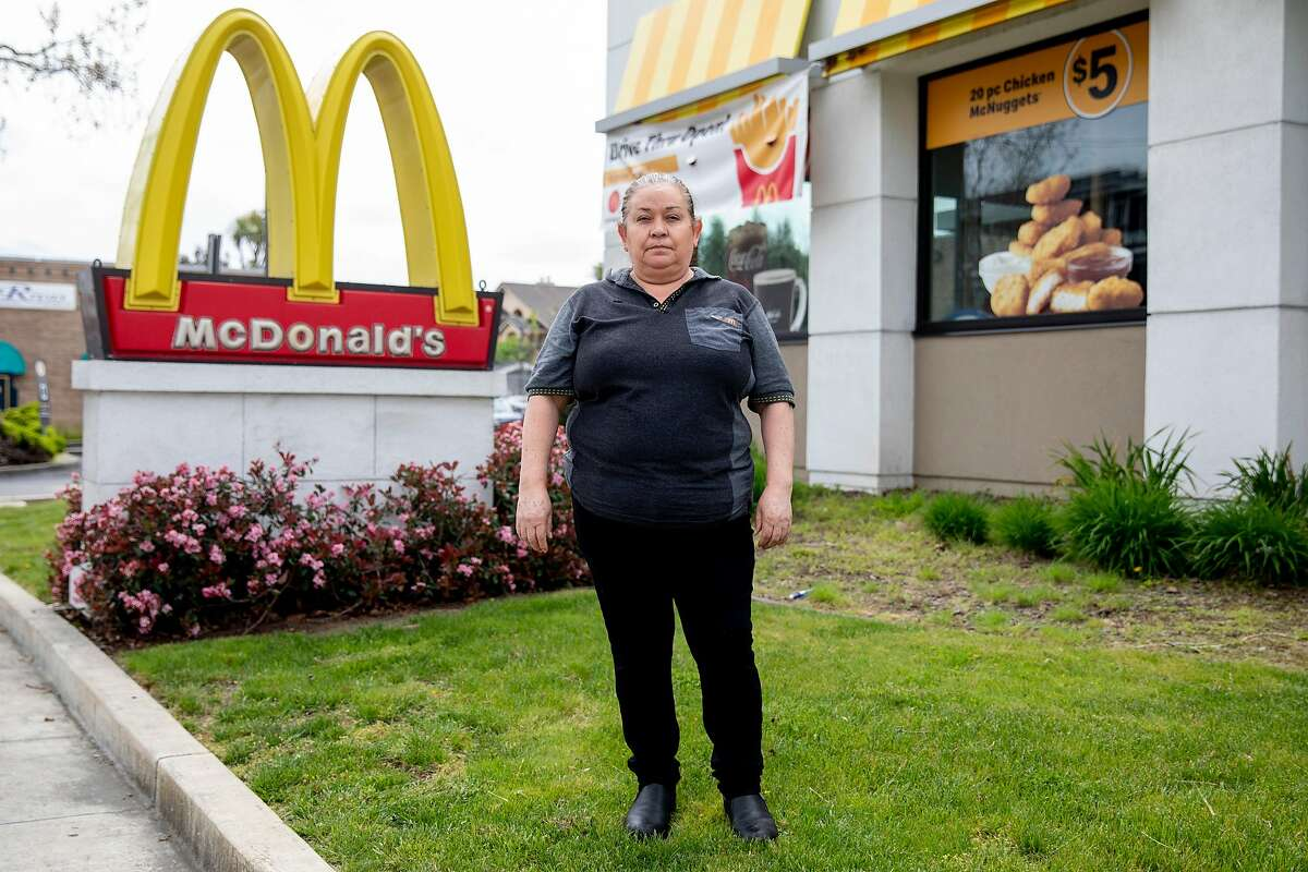 Guadalupe Sanchez poses for a portrait outside of the McDonald's restaurant she works at in San Leandro, Calif. Friday, April 17, 2020. Sanchez is a McDonald's worker who would be affected if Newsom decided to suspend the minimum wage increase that is scheduled to take place in California in 2021.
