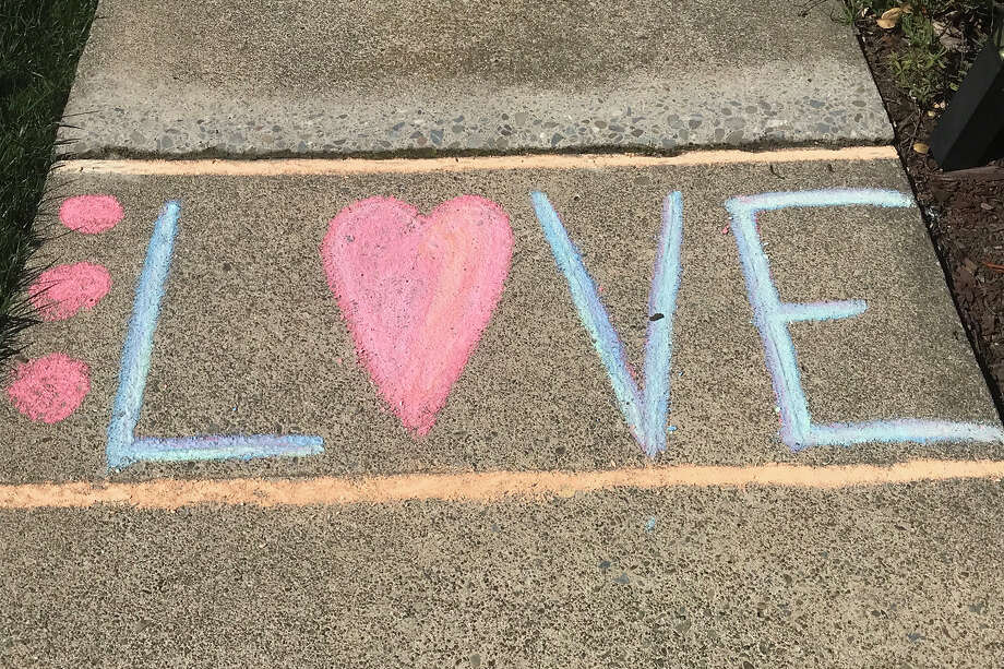 In the era of the coronavirus pandemic, sidewalk chalk is everywhere. Whether to communicate with loved ones on their birthdays, offer comfort and encouragement to strangers, or simply as an afternoon activity for the kids, pastel is popping up all over. Photo: Emily Lindorfer