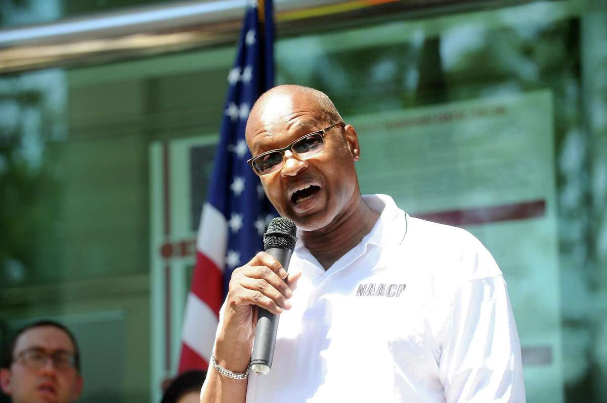 Stamford NAACP President Jack Bryant speaks during the community vigil to stand against hatred and violence outside of Government Center in downtown Stamford, Conn. on Wednesday, August 16, 2017. Bryant died in April 2020 with COVID-19.