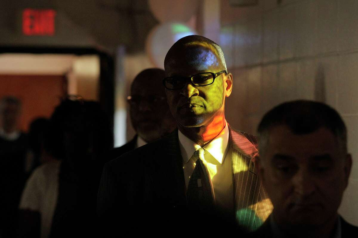 Stamford chapter of the NAACP Jack Bryant is illuminated in light while processing in during a communal prayer vigil in honor of the families and in memory of The Emanuel A.M.E. Church