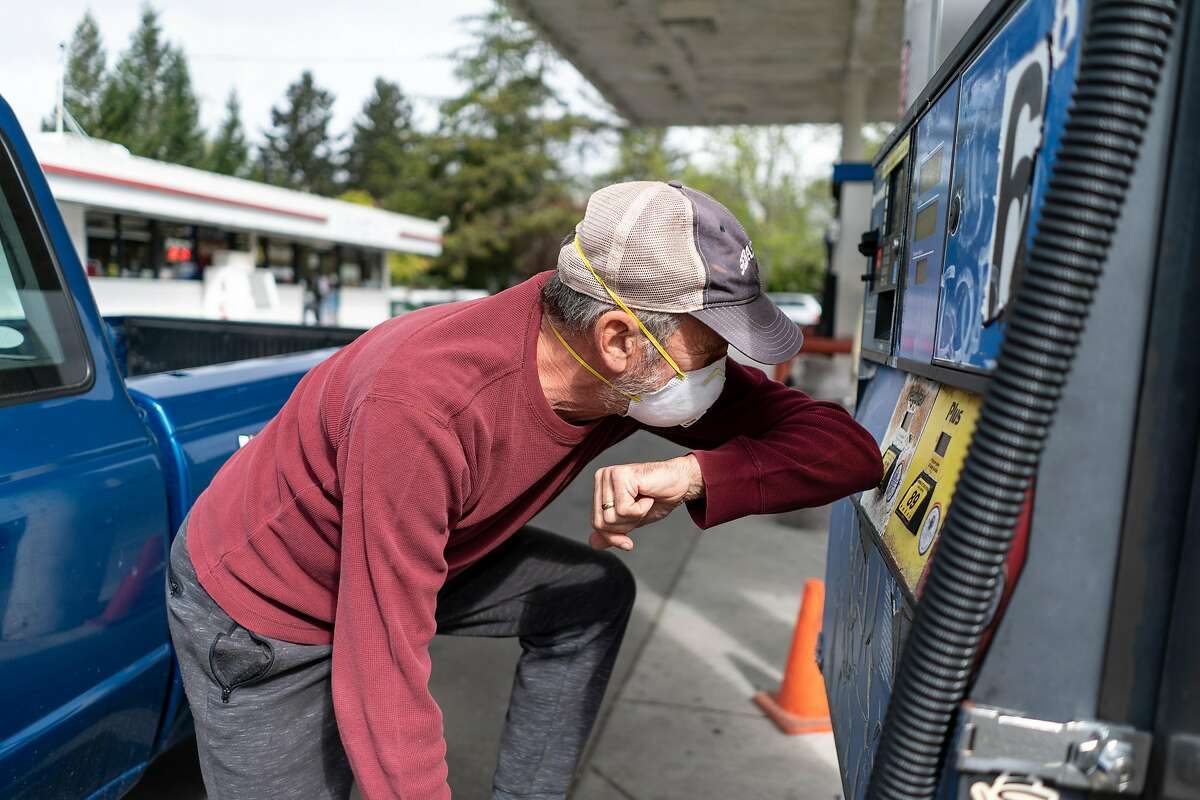Paul Berg, 64, gets gas in town for his truck and his gas tanks in Sebastopol, California on April 17, 2020.