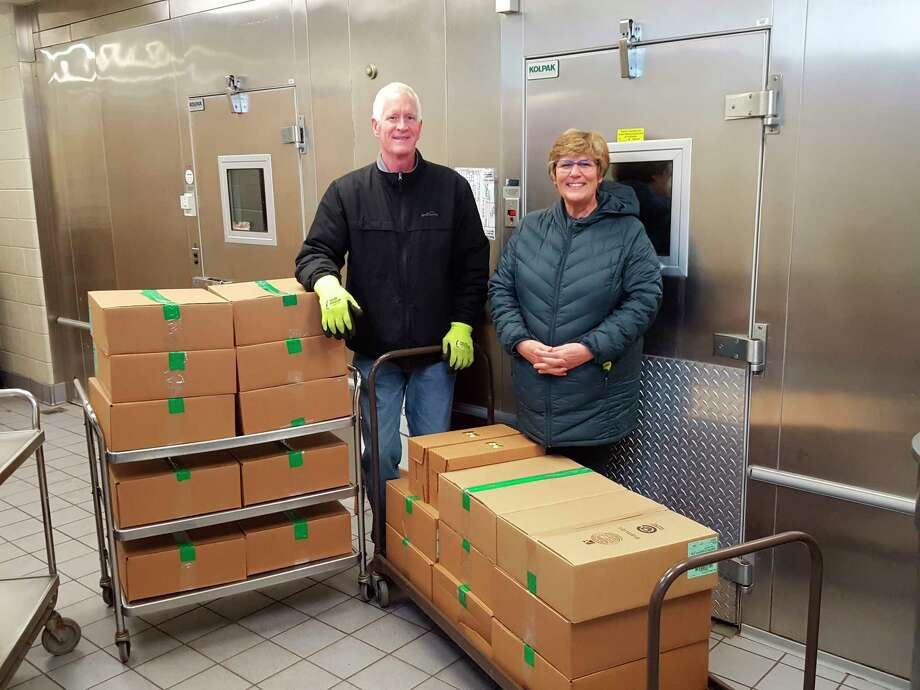 Don and Sandy Tomaszewski represent Materne North America Corporation in Grawn, which donated 22,000 GoGo Squeez applesauce pouchesto the Kaleva Norman Dickson, Bear Lake and Oneakama Consolidated Schools food service programs. (Courtesy photo)