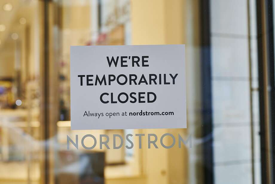 """A """"Temporarily Closed"""" sign hangs in the window of Nordstrom Inc. store in the Midtown neighborhood of New York, U.S., on Friday, March 20, 2020. Some retail segments, such as grocery chains and Walmart, may benefit from the coronavirus outbreak. But for a sector already battered by the shift to online retailing and other structural changes, the coronavirus only portends more pain. Photographer: Gabby Jones/Bloomberg Photo: Gabby Jones, Bloomberg"""