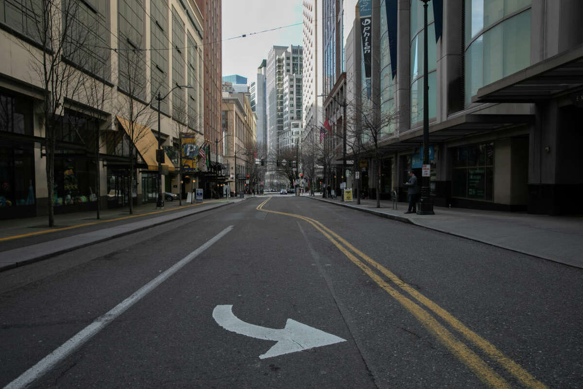 Normally busy downtown streets are virtually empty at rush hour due to coronavirus. Click through the gallery to see before dn after pictures of Seattle during the COVID-19 pandemic.
