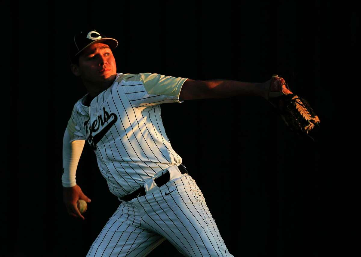 Luke Ramirez #16 of Conroe warms up before a high school baseball game against The Heights during the Ferrell Classic at Conroe High School, Thursday, March 5, 2020, in Conroe.