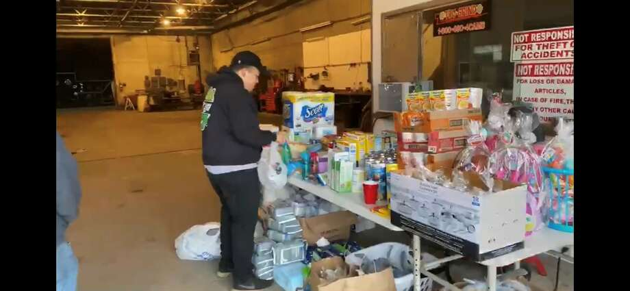 Jonathan Reyes assembles a number of supplies, including cleaning supplies and canned goods, for his weekly donation pickup that has occurred for the last month. Photo: Courtesy Photo/Jonathan Reyes