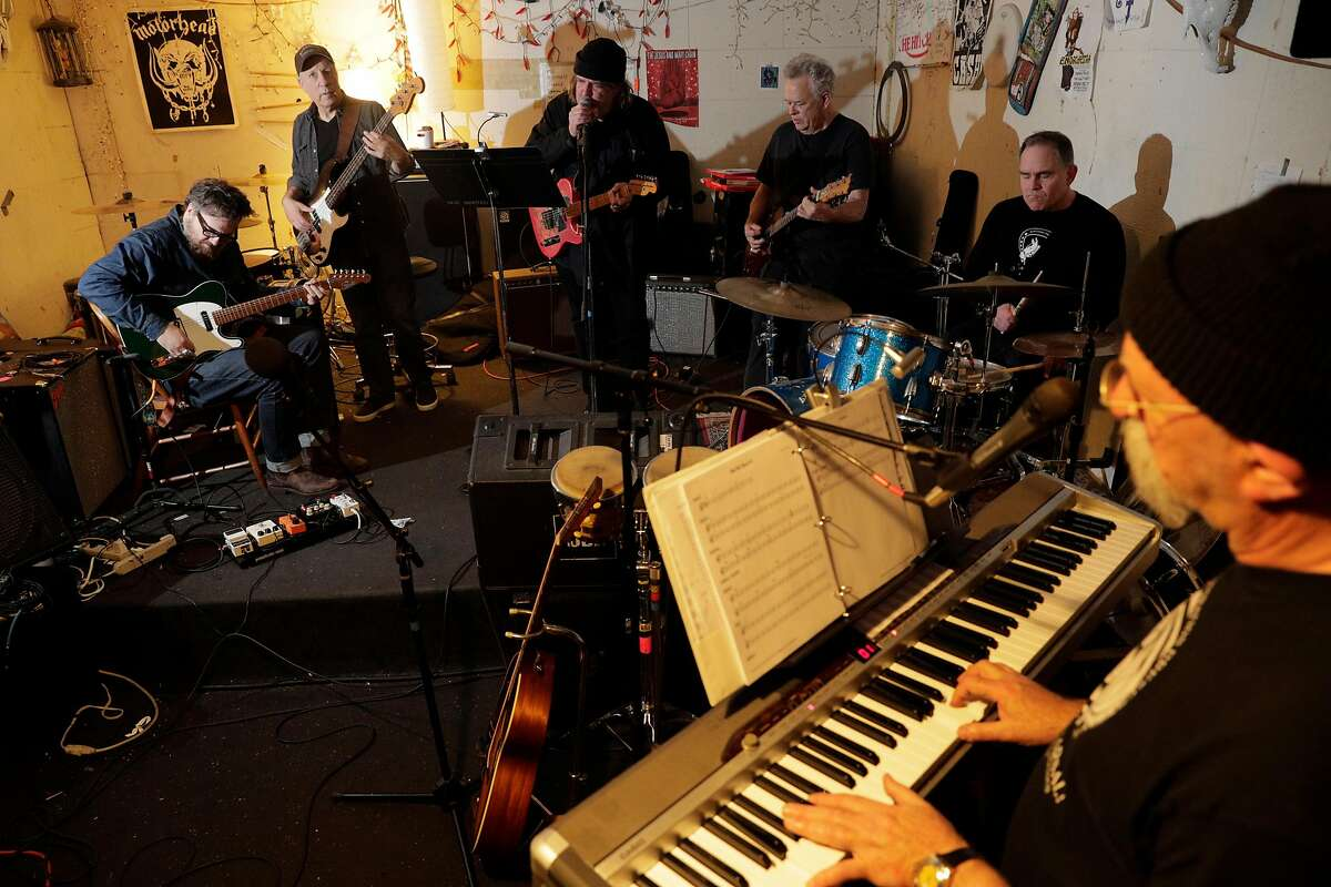 Musicians, from left, Tom Heyman, Maurice Tani, Peter Case, Larry Levy, John Moreman, and Joshua Raoul Brody rehearing for