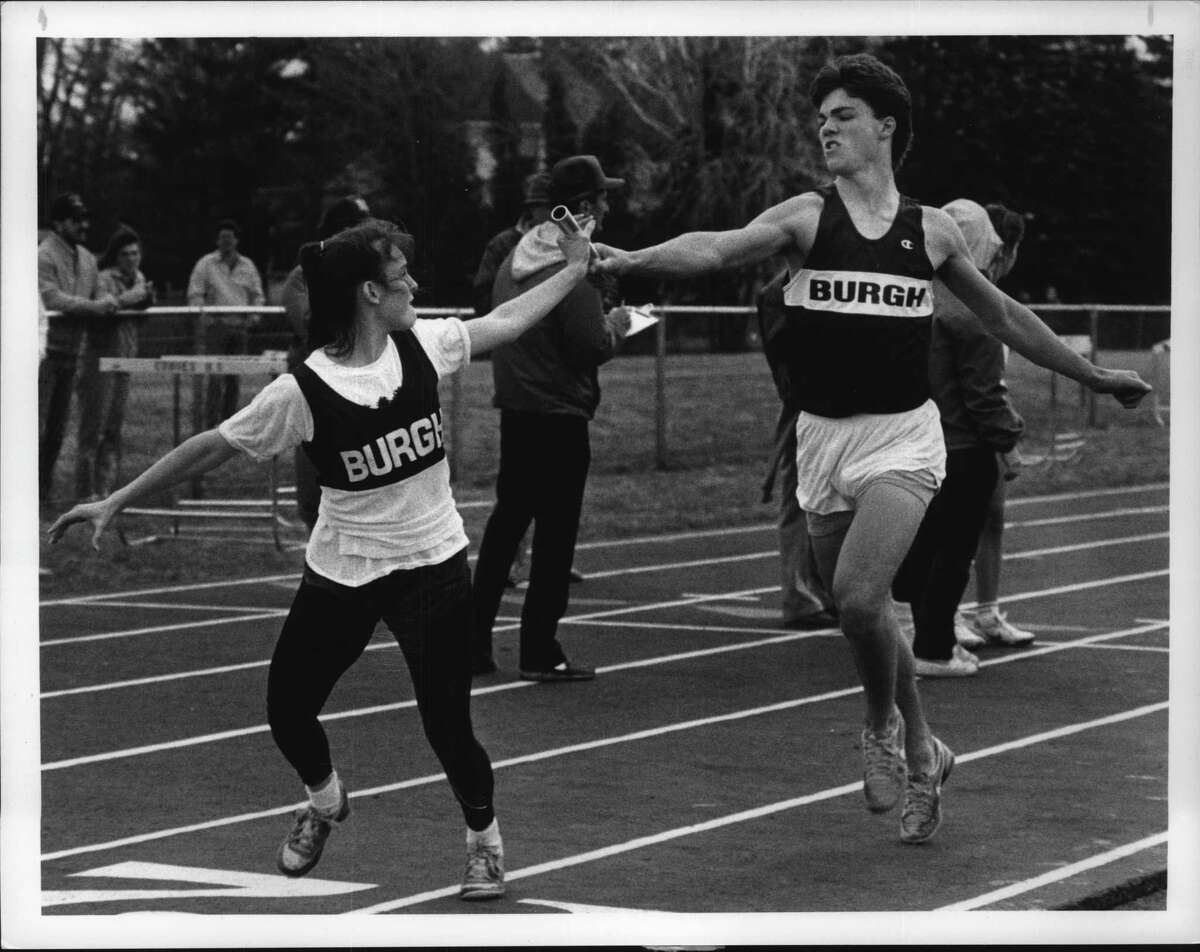 Lansingburg High School track athlete Peter Stewart Undated (R) hands off baton to teammate Keri McCauley in the co-ed 4 X 800 meter race that they won at Cohoes High School, New York. April 18, 1989 (John Carl D'Annibale/Times Union Archive)