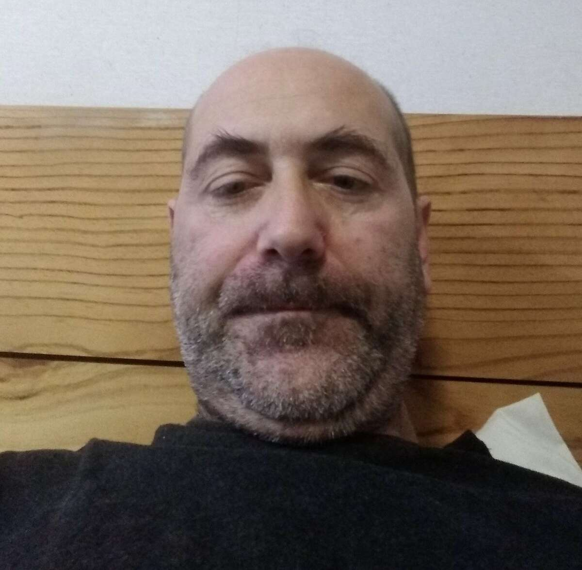 Brian McFarland, who had been staying at the Multi-Service Center South shelter before being placed in a city-provided hotel in April for isolation during the coronavirus crisis, said he appreciated the hotel room. He took this self portrait on April 17, 2020, as he lay in his hotel bed with a fever.