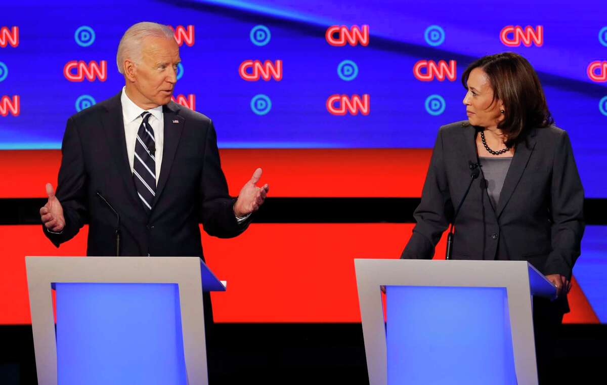 FILE - In this July 31, 2019 file photo, former Vice President Joe Biden speaks as Sen. Kamala Harris, D-Calif., listens during the second of two Democratic presidential primary debates hosted by CNN in the Fox Theatre in Detroit. As presumptive Democratic presidential nominee Joe Biden begins the process of choosing a running mate amid the coronavirus crisis, managing the pandemic has become its own version of an audition. For potential picks, lobbying for the job means breaking into the national conversation, positioning themselves as leaders and executing at their day job. (AP Photo/Paul Sancya)