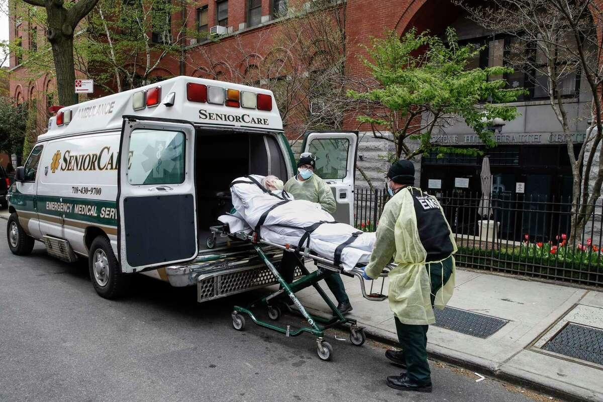 A patient is loaded into the back of an ambulance by emergency medical workers outside Cobble Hill Health Center, Friday, April 17, 2020, in the Brooklyn borough of New York. The despair wrought on nursing homes by the coronavirus was laid bare Friday in a state survey identifying numerous New York facilities where multiple patients have died. Nineteen of the state's nursing homes have each had at least 20 deaths linked to the pandemic. Cobble Hill Health Center was listed as having 55 deaths. (AP Photo/John Minchillo)