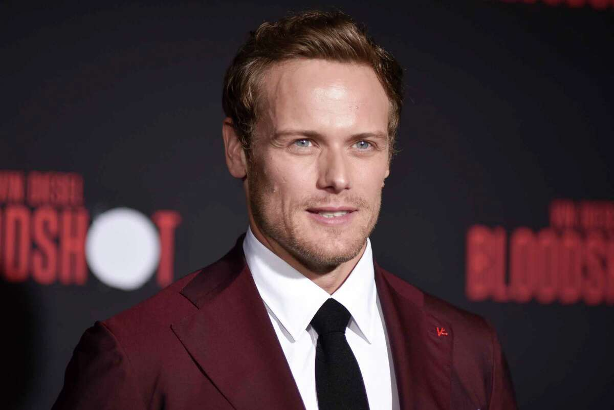 """FILE - This March 10, 2020 file photo shows Sam Heughan at the LA premiere of """"Bloodshot,"""" in Los Angeles. Heughan, star of the Starz series """"Outlander,"""" spoke out on social media about what he calls a€œsix years of constant bullying, harassment, stalking and false narratives.a€ The 39-year-old Scottish actor said on Instagram and Twitter Thursday, April 16, that hea€™s been subjected to claims including that he has misled and tried to extort fans for money. (Photo by Richard Shotwell/Invision/AP, File)"""