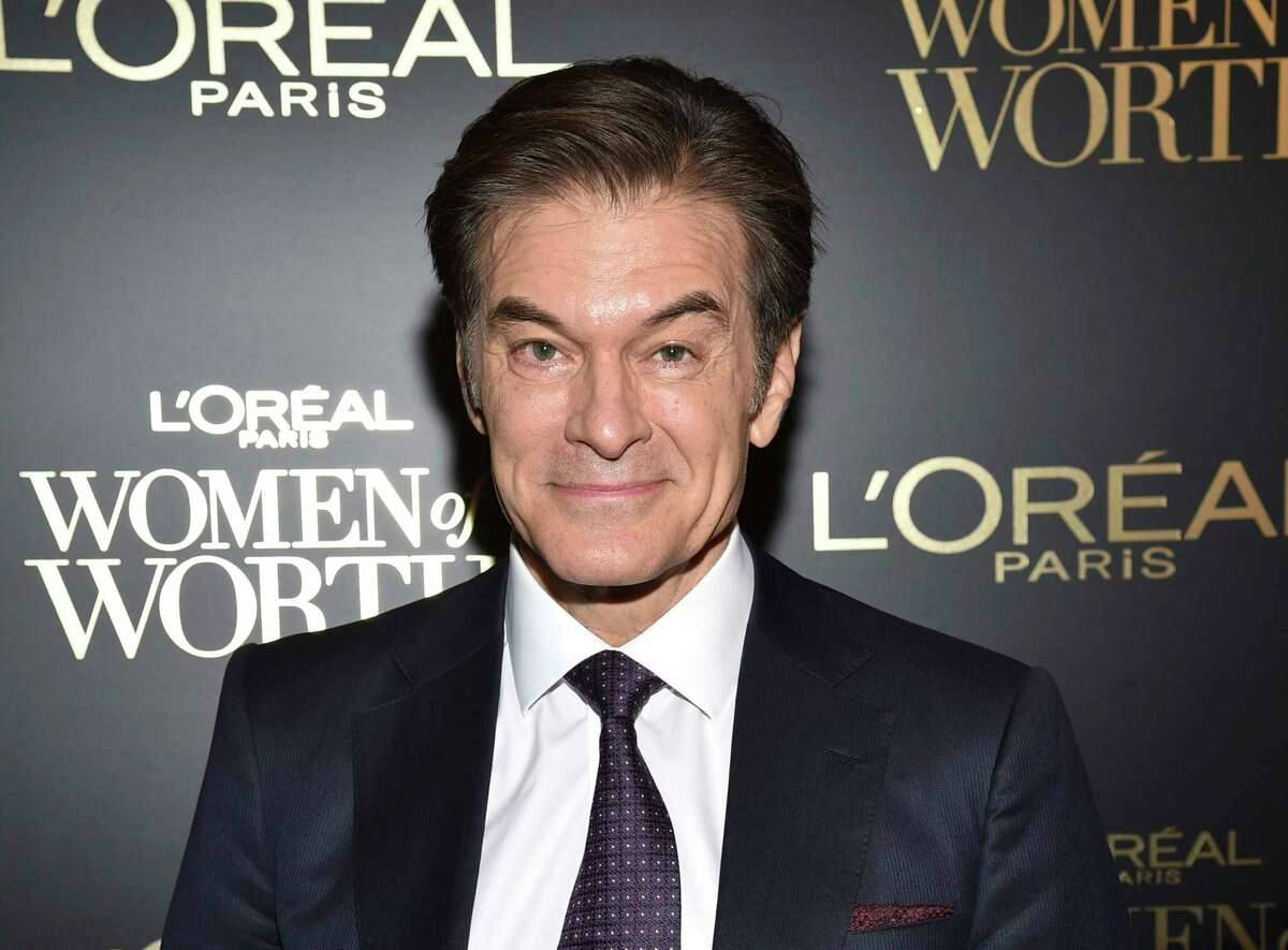 FILE - This Dec. 4, 2019 file photo shows Dr. Mehmet Oz at the 14th annual L'Oreal Paris Women of Worth Gala in New York. Oz says he misspoke during a Fox News Channel appearance this week where he said reopening schools was a a€œvery appetizing opportunitya€ despite the coronavirus epidemic. In a Twitter post late Thursday, April 16, the heart surgeon and television talk show host said he recognized his comments had confused and upset people, and that was never his intention. (Photo by Evan Agostini/Invision/AP, File)