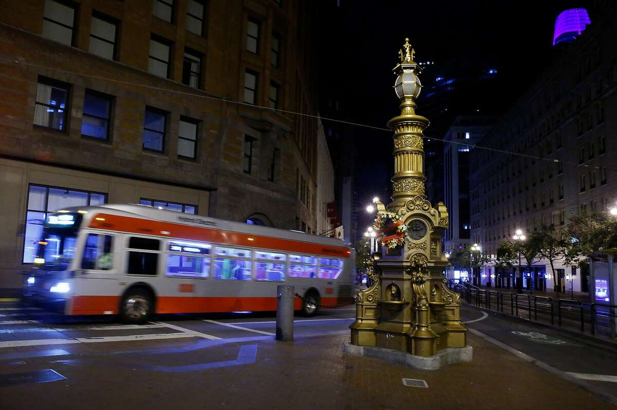 A 38-Geary bus rolls past Lotta's Fountain on the 114th anniversary of the 1906 earthquake in San Francisco on April 18, 2020.